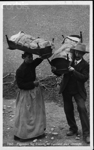 Swiss Couple Carrying Cradles